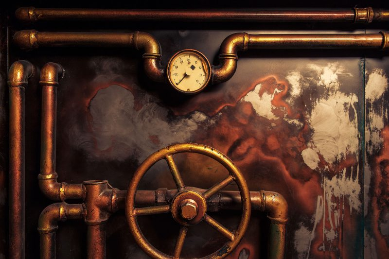 Foto : background vintage steampunk from steam pipes and pressure gauge